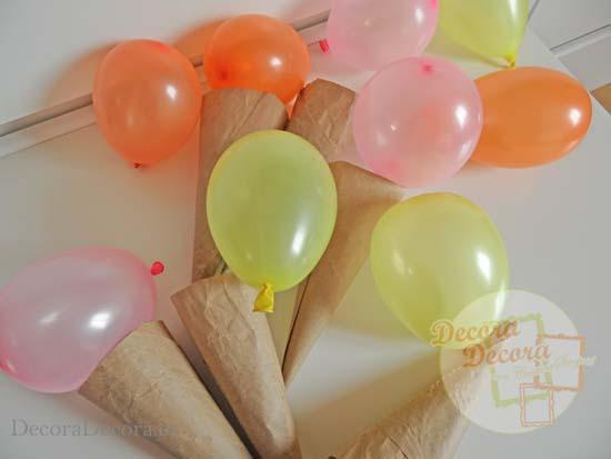 Hacer cucuruchos de globos para decorar fiestas.