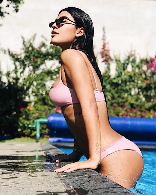 Hot sexy Bikini model in pool style fashion outfit