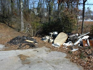 Possible environmental concerns noted during a Phase I EA - Shingles may contain asbestos