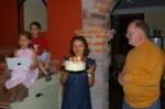 Agnieszka holding Nadia's birthday cake.