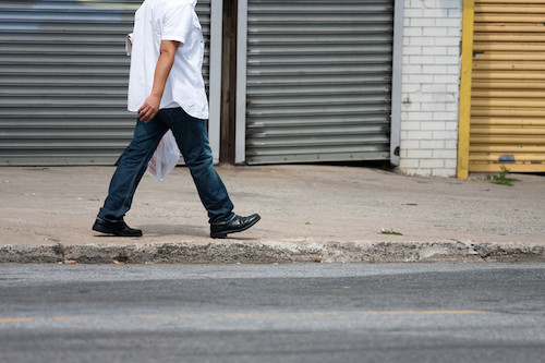 man walking in street used for blog on editing by yourself