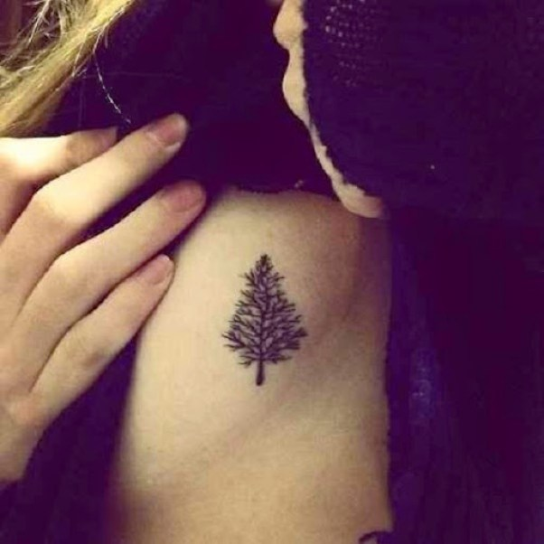 small tree tattoo design on side rib cage