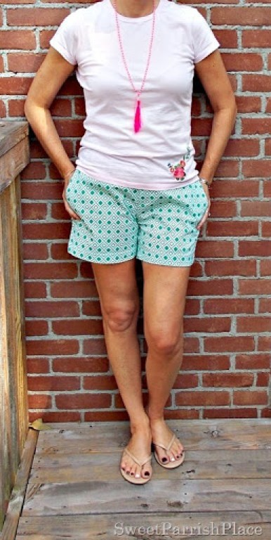 Geometric green and white shorts, pink tee, nude sandals, pink tassell necklace1