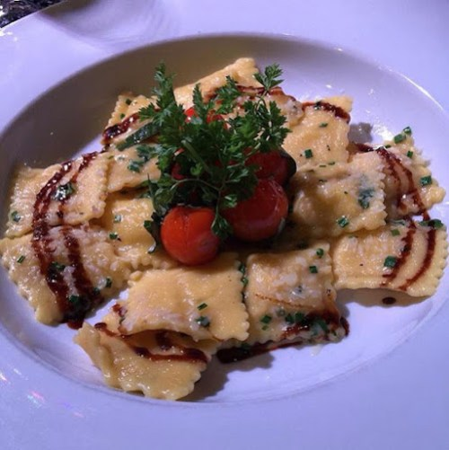 Red Scooter Entree was spinach and feta ravioli with cherry tomatoes