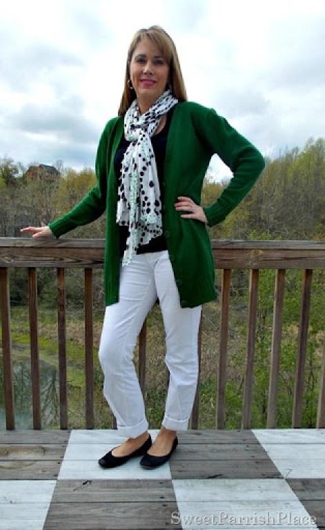 White jeans, black tank, green cardigan, black flats