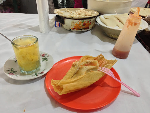 Chicken tamale (10 pesos) with hot pineapple punch at the market beside the San Cristobal zocalo.