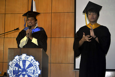 Ma'am Esposa announces the candidates for graduation while Sir Jefferson Cortez interprets.