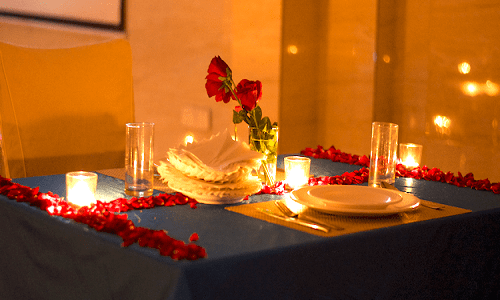 Plan a surprise candle light dinner