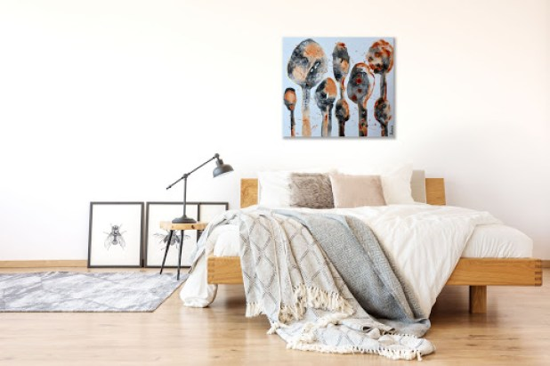 Abstract Trees of Nature Painting hangs above unmade bed