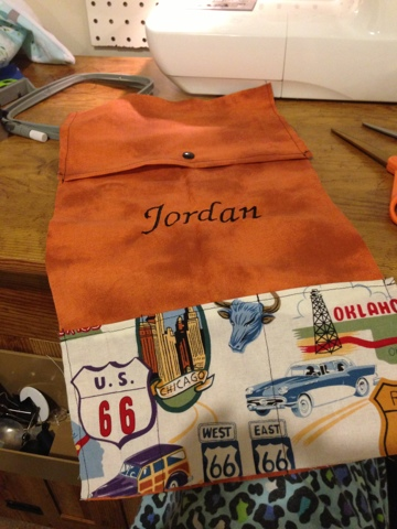 Embroider or use heat transfer vinyl to add the child's name to the carrier.