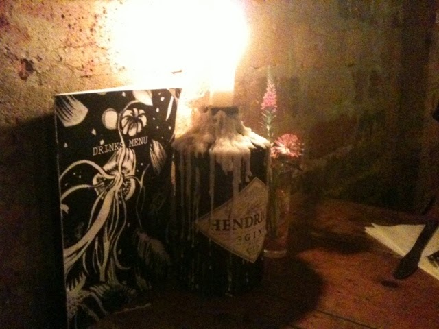 Candles in gin bottles