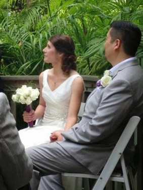bride and groom seated.