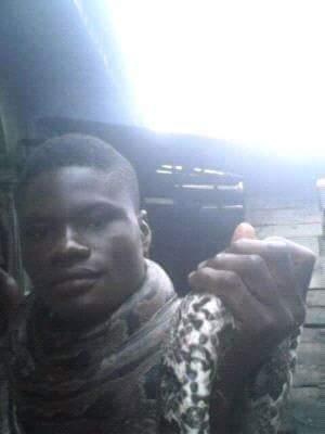 Nigerian Man Kills A 'Bush Animal',Poses With It(Pics)