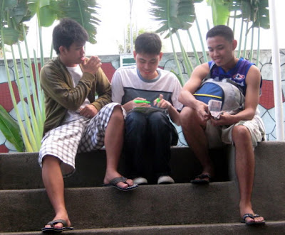 Ninongs' Andrew, Ace and Jerome prepare to distribute money to students.