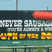 800px-south_of_the_border_sign_10_-_you_never_sausage_a_place.jpg
