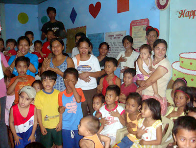 Buntong Palay Day Care Center pupils together with their parents and siblings