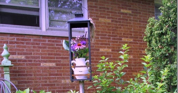 Trash To Treasure Repurposing A Lantern Into Garden Art