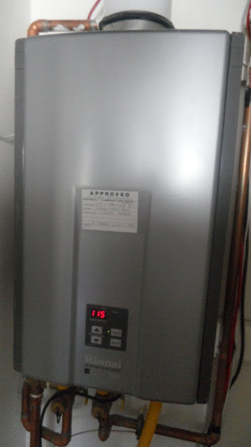 Energy-efficient tankless water heater that provides instantaneous hot water.