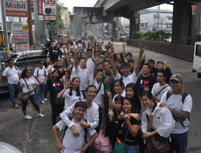 Students pose outside MCCID Main Cubao Campus.