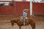 Young boy showing off his lasso skills.