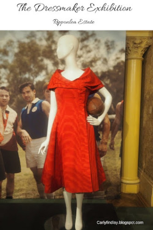 Kate Winslet's costume in The Dressmaker - red structured dress, mannequin holding a football.