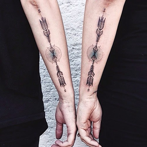 matching arrow tattoos arms