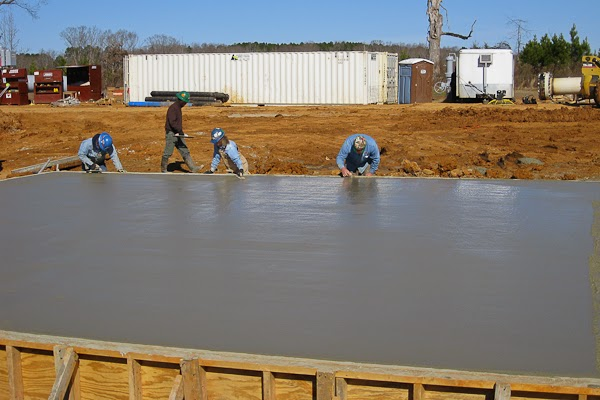Systems Contracting Finishing Large Concrete Foundation