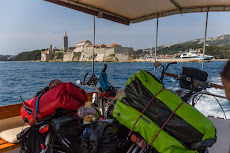 Taking a taxi boat with the bikes from the island Rab to the island Pag.