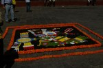 An Aztec painting on a cobblestone street in front of teh Parroquia on the main square (Jardin Allende) in San Miguel de Allende, Mexico on the Day of the Dead (Dia de los Muertos).