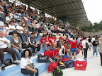 People & players sitting in Pacevecchia Stadium watching the finals.JPG