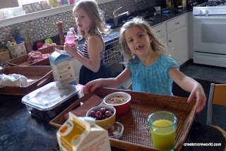 Liy and Emma make breakfast for Mommy.  (See the bowl of pills, lawl)