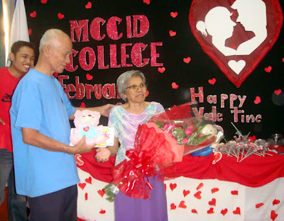 Sir Remberto Esposa presents gifts to February Birthday Celebrant Ma'am Remedios Esposa courtesy of MCCID Students.