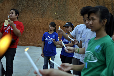 Students light up the candles for dedication