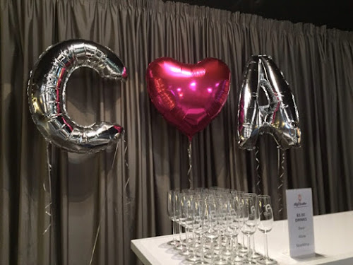 Red Scooter ceremony room, foil balloons in our initials and a pink heart