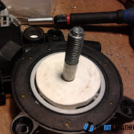 attaching_threaded_rod_to_motors_axle.jpg