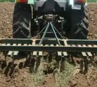 tillage implement pulled by a tractor