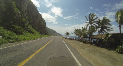 Beautiful tight winding roads through lush green forests would open up and hug the coast along the Pacific