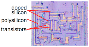 With the metal layer removed from the 8008 processor die, the underlying silicon is visible The