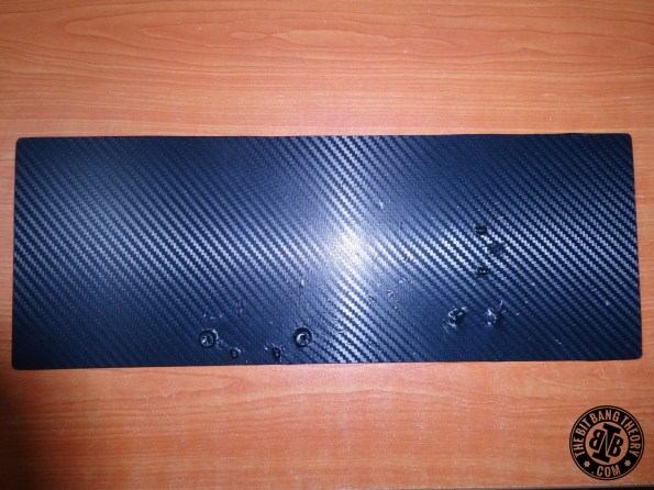Applying carbon fiber vinyl to top layer