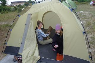 breaking down the campsite isn't Emma's favorite task.