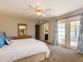 picture of master bedroom with French doors looking to backyard