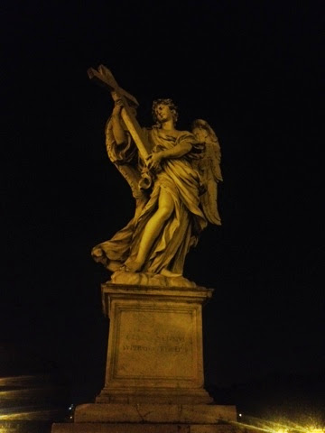 Statues glowing at night in the city of Rome