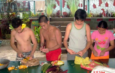Students chopping vegetables.