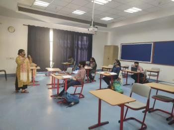 Students of Genesis Global School return to campus