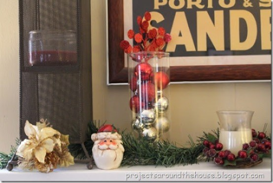 Christmas mantel, ornaments in a vase