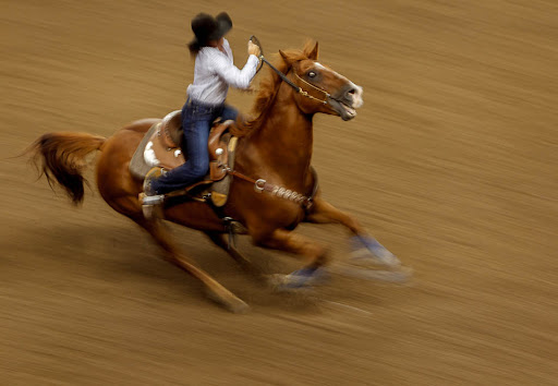 Reagan Dillard competes in the Barrel Racing competition at the Days of '47 Rodeo at the Maverik Center in West Valley City, Utah on Tuesday, July 24, 2012