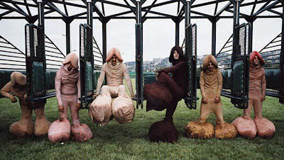 sack race photo - six men dressed in full-body penis costumes standing in the starting gates at a race-track