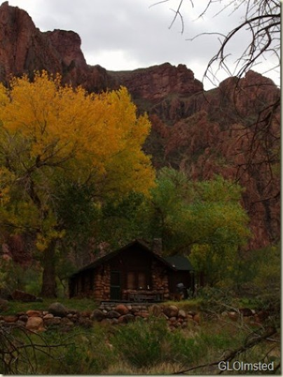 Ranger residence under fall trees and canyon walls Grand Canyon National Park Arizona