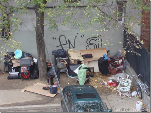 A homeless man and his makeshift 'home' in New York City.