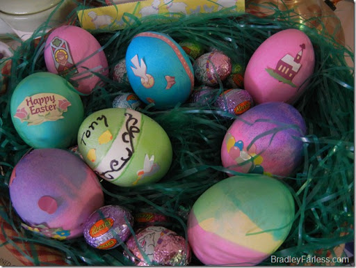 Dyed Easter Eggs in a basket with fake grass.
